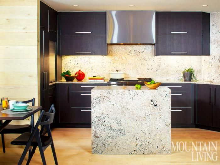 Sleek charcoal stained cabinets offer a handsome contrast to the light