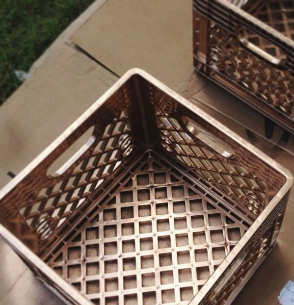 Spray paint a cheap plastic milk crate