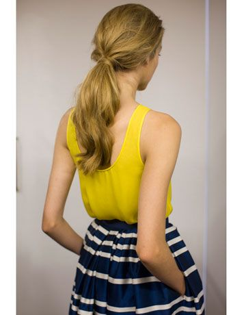"Harper's Bazaar is calling this the ""French Girl Ponytail."" We like the effortless feel. Use Radiant Fix Hairspray to get a similar look- http://www.gloprofessional.com/radiant-fix-hairspray"