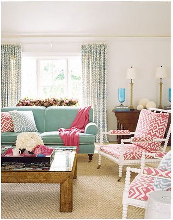 The fresh pink and aqua combination in this living room is really quite lovely (from House Beautiful)