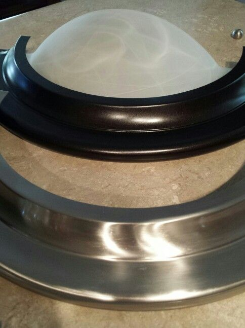 light fixtures change them a can of rust oleum metallic spray. Black Bedroom Furniture Sets. Home Design Ideas