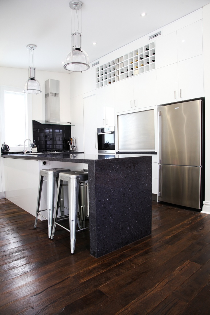 "Caesarstone ""Black Rocks"" for kitchen benchtops (no waterfall edge though)"