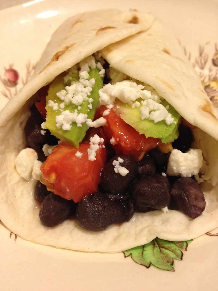 Black bean, tomato, avocado, goat cheese taco. Healthy and very good!
