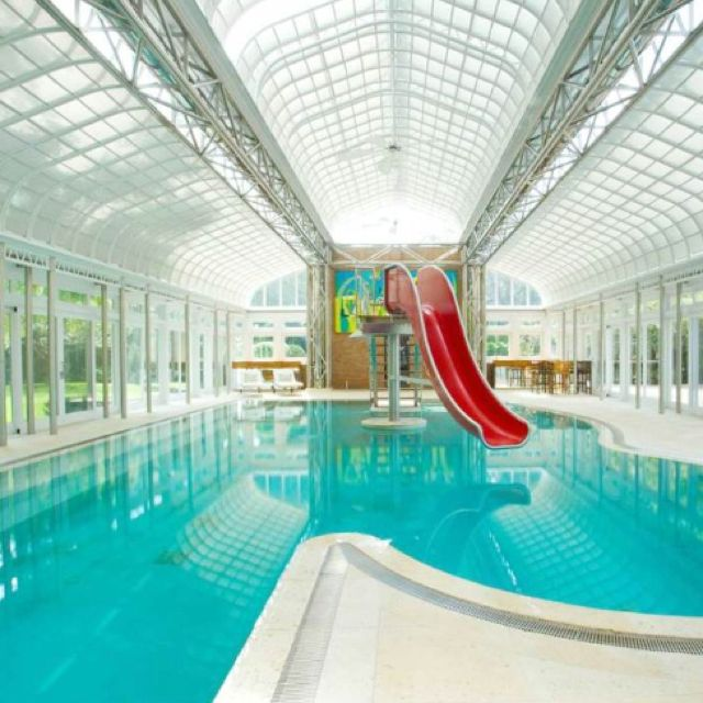 Indoor swimming pools with slides example for Indoor pool with retractable roof