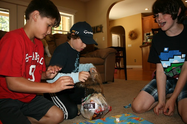 Tape Ball Game! Wrap candy in layers of saran wrap to form a large ball. One kid gets to peel back the layers to get the candy until the next person can roll a double on a pair of dice. Then it's their turn to unwrap for candy. It's a mad dash for sugar!