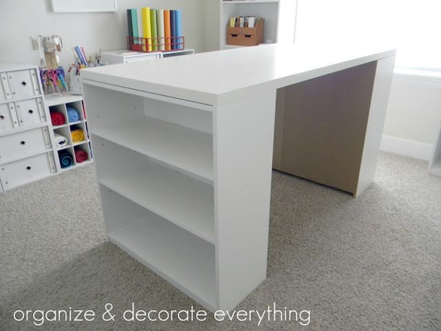 DIY Craft Table; tabletop at IKEA for $25 and two $15 Walmart bookshelves.