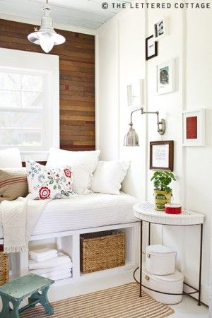 White with little bits of color with the warmth of the wood.