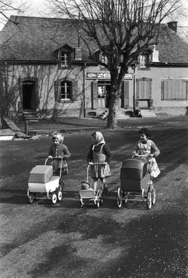 We pushed our dolls in little carriages
