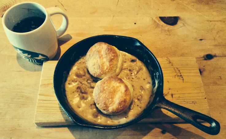 Cowboy breakfast of Buttermilk biscuits and sausage gravy in a skillet ...