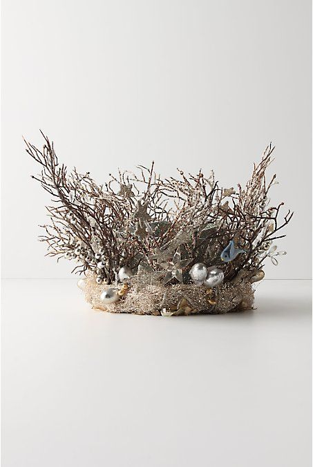 Bird's Nest Tree Topper from Anthropologie. I like the idea of a nest as a topper...more appropriately pagan than an angel or star...