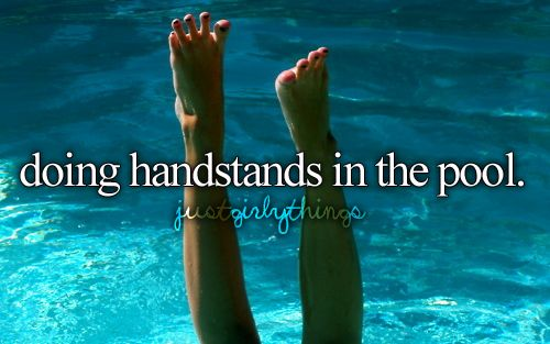 doing handstands in the pool.