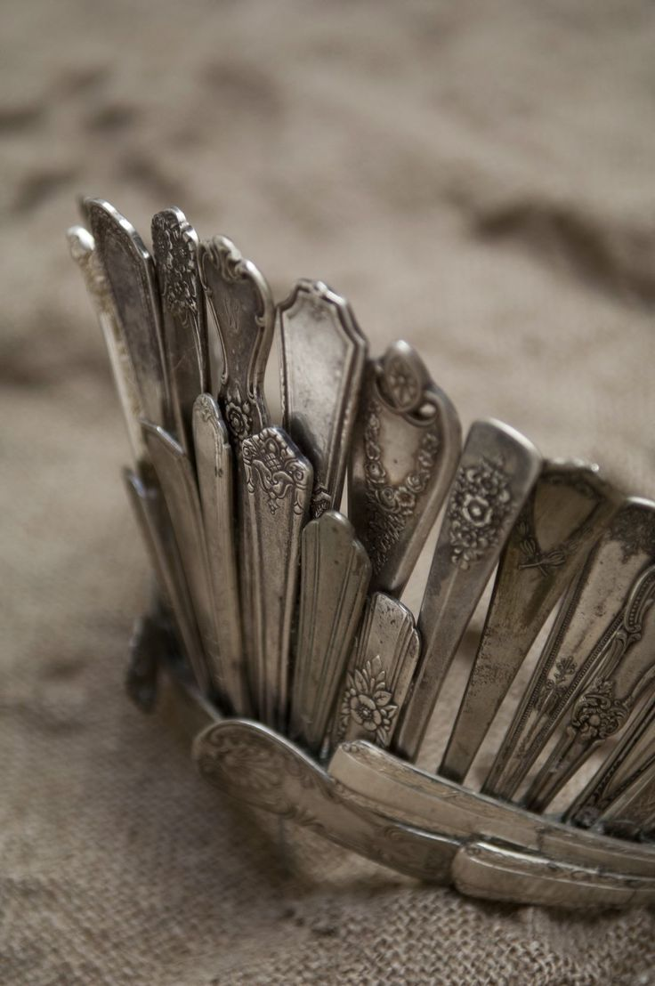 FleaingFrance.......the work of Alicia Buszczak.     Crown of  vintage flatware