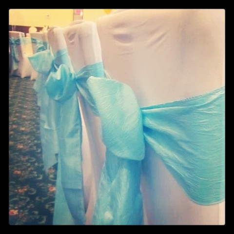 white spandex chair covers and light blue crinkled taffeta sashes