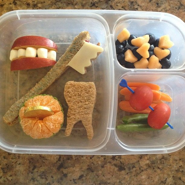 Dental bento box. Wheat bread cheese sandwich, peanut butter apple sandwich with marshmallows, mixed fruit and veggies. Pediatric Dental World - pediatric dentist in Highland Village, TX @ www.pediatricdentalworld.com