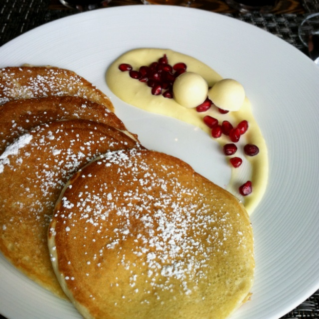 Ricotta pancakes with passion fruit cream and pomegranate at Tom ...