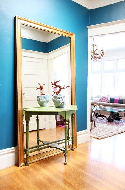 large floor mirror for a small entry, great color with gold mirror frame via Apartment Therapy