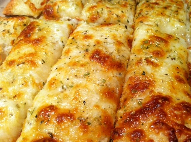 cheesy garlic breadsticks--going to try these with the other half of ...