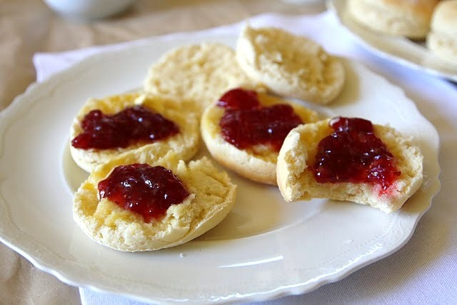 fluffy scones with raspberry jam and whipped cream
