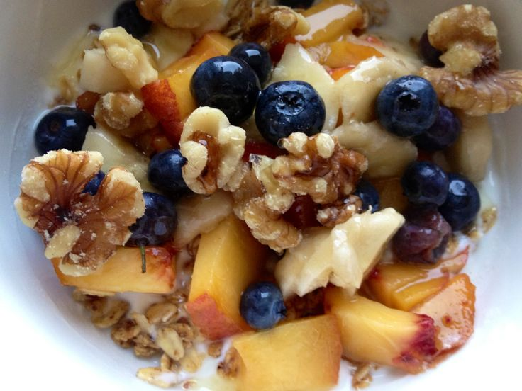 Yogurt, granola, peaches, bananas, blueberries, walnuts, and a drizzle ...