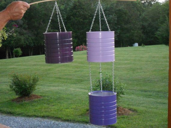 Recycled cans hanging flower pots metal planters for Recycled flower pots