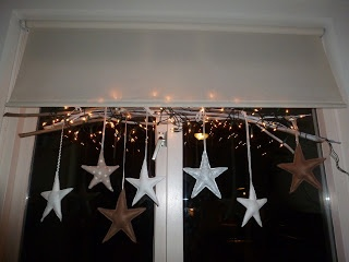 different stars with christmas lights to decorate my window