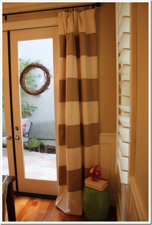 Wide horizontal striped drapery cream panels with brown fabric