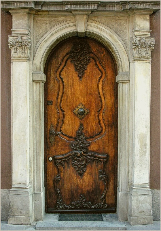 Old Wooden Door and its Carved Stone Frame