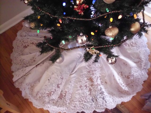 This is my wedding dress converted to a christmas tree skirt so it can