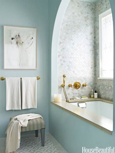 The custom watery blue of the polished Venetian plaster walls picks up the blue in the floor tiles.