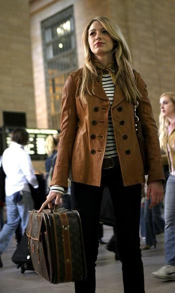 """The first and most iconic outfit: Serena getting off the train at Grand Central Station looking like the well-traveled, well-heeled teen she is. The Louis Vuitton luggage, the Breton striped tee and the jaunty scarf scream, """"I've been to Europe and back more times than you can count.""""'Gossip Girl' Series Finale: A Look Back At The Fashion From All 6 Seasons (PHOTOS)."""