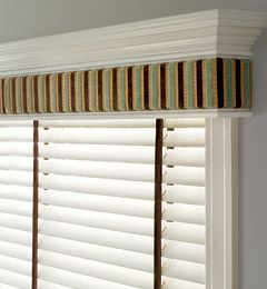 Corniced window treatments.