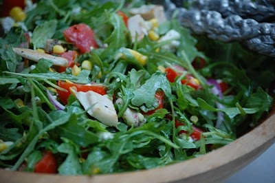 arugula salad with corn, tomatoes, and blue cheese