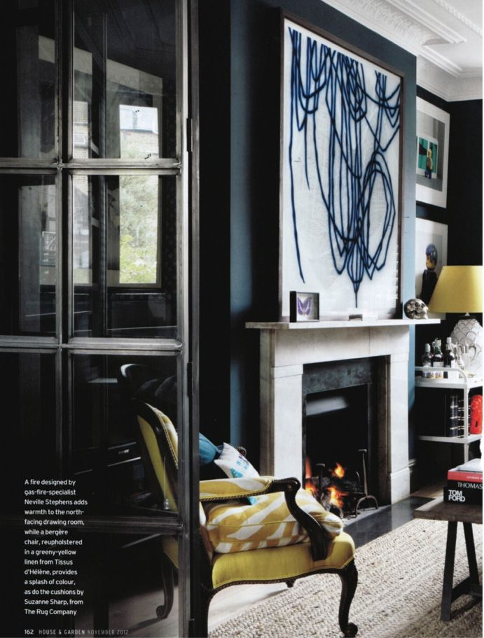 Black walls, big art, citron accents