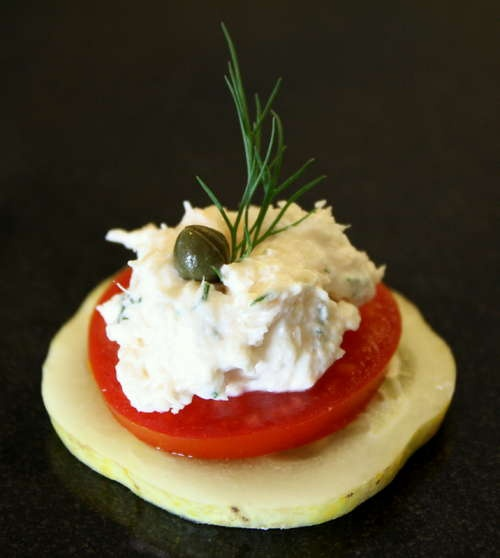Shrimp dip on top of a tomato and lemon cucumber slice... I'd probably ...