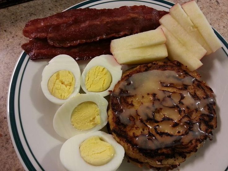 Cinnamon roll pancakes, apple slices, boiled eggs and turkey bacon. # ...