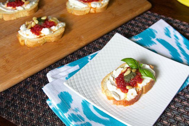 Goat Cheese Crostini with Basil and Sundried Tomato Pesto photo