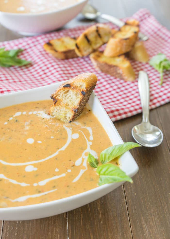 Fire-roasted tomatoes & fresh basil layered into a creamy soup - it's...