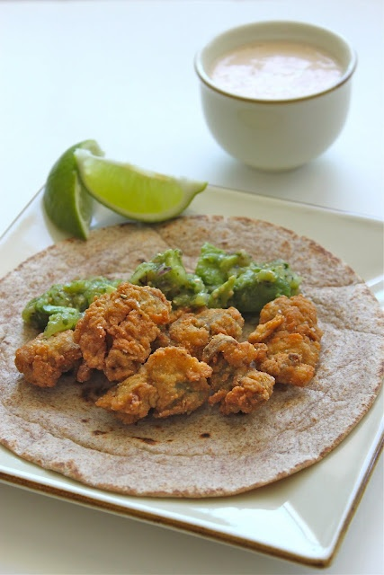 fried oyster tacos with tomatillo-avocado salsa + chipotle-lime crema.