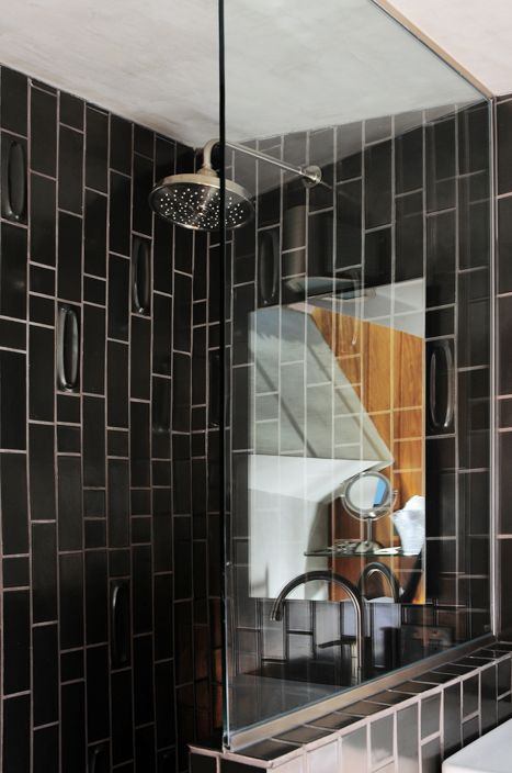 Hotel lautner black tile shower bathroom remodel ideas for Black tile bathroom designs