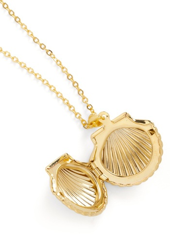 We love this adorable locket! Great little piece to accessorize your beach and pool looks.