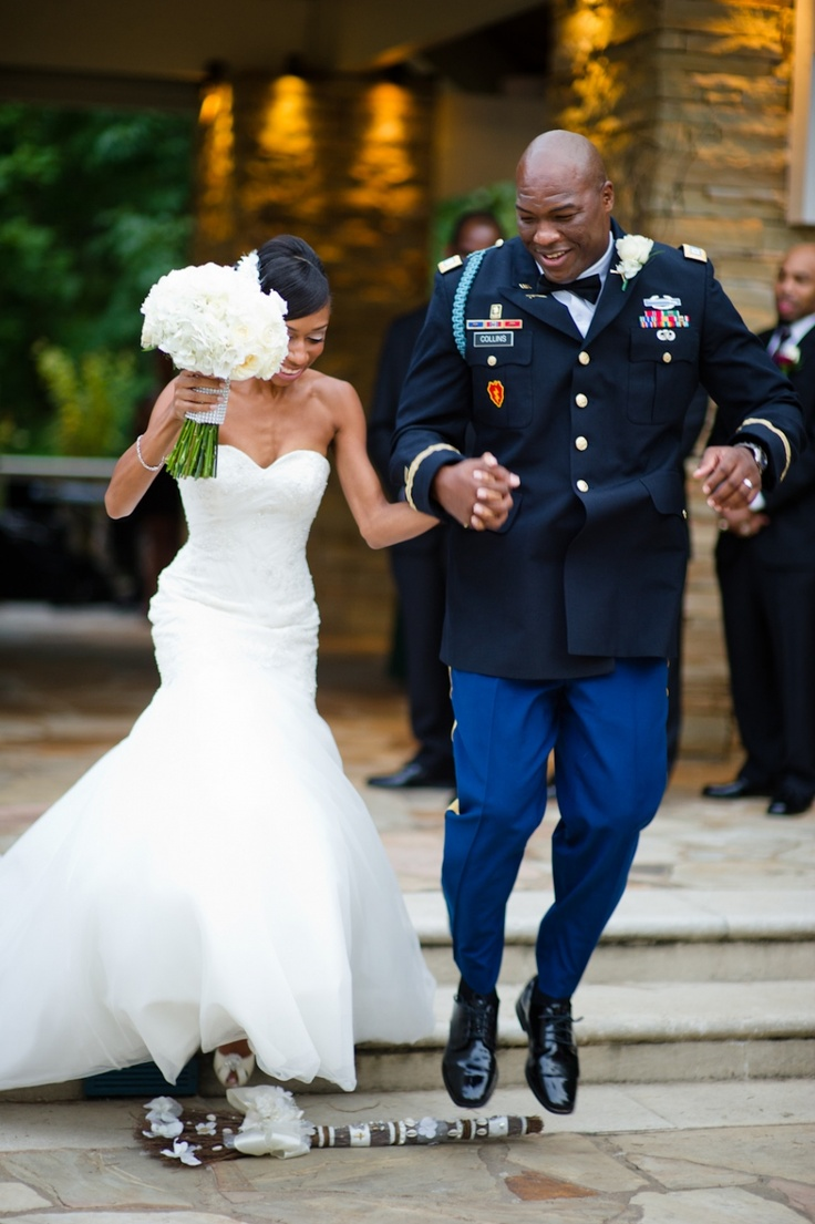 Military wedding jumping the broom