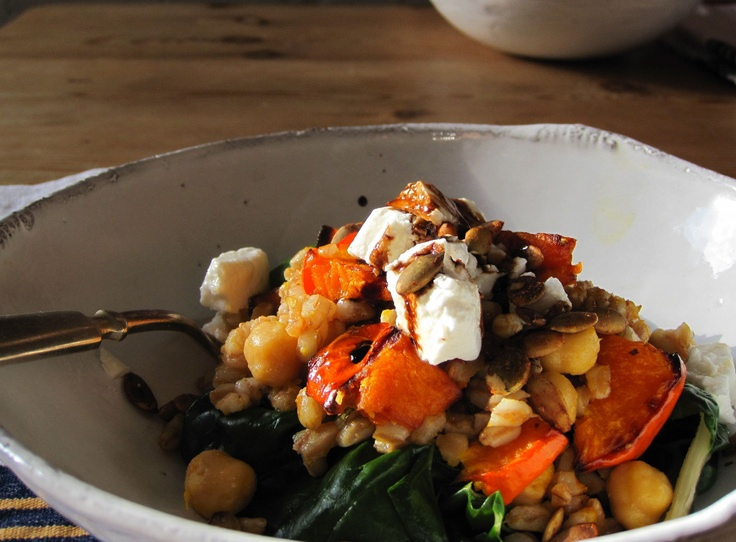 Warm farro and roasted squash salad over wilted chard
