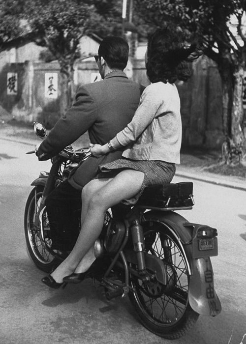 A couple on a motorcycle in Taipeh, China, 1959. Photo by John Dominis.