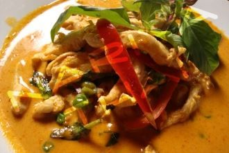 ... vegetables and coconut milk in a richly spiced red curry sauce from