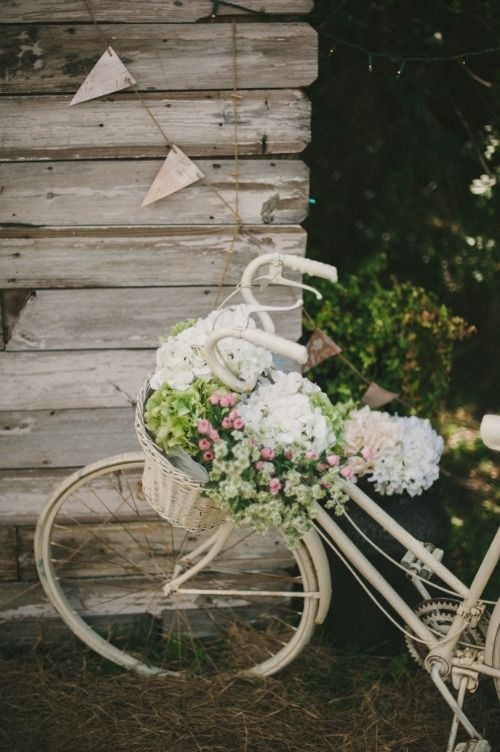 Vintage bikes + Spring Flowers with a little touch of bunting..... #weddinginspiration #fauxflowers