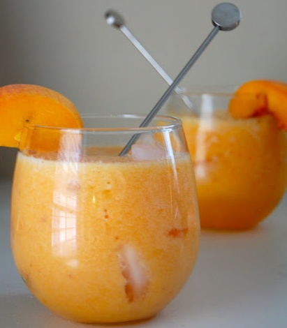 ... peaches and lemonade in a blender until smooth. Pour vodka over ice in