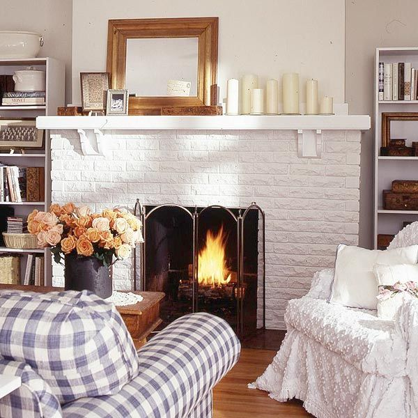 white brick fireplace makeover painted white brick