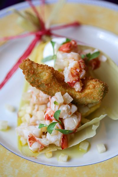 Sweet corn humita with lobster, garnished with fried avocado