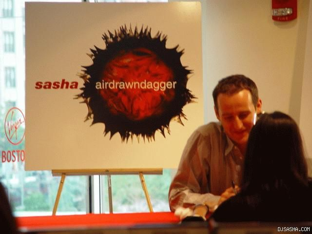 Dj sasha signs copies of airdrawndagger