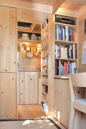 Built in cabinets...for art books, pieces, supplies. Utilization of vertical space. Jay Shafer's Tumbleweed Houses.